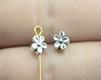"25 flower shaped ""pucks"" 7mm antique silver metal beads"