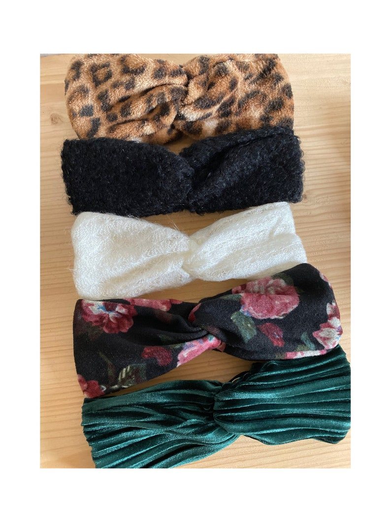 Crossed headbands all soft and warm from birth to adult.