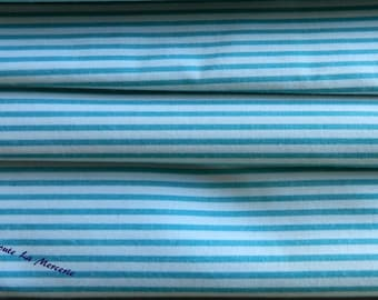 Green and white striped fabric cut