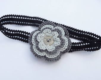 Flower headband crocheted in shades of grey