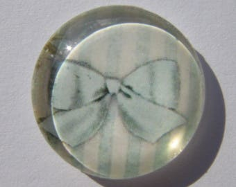 Glass cabochon round in 20 mm image bow with blue stripes vertical