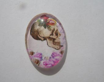 Glass cabochon oval 25 X 18 mm with skull image flower