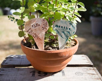 2 marks plants, Garden ceramic green and Brown Enamel signs