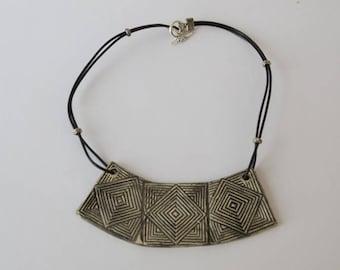 Made up of 3 square ridged Black ceramic bib necklace