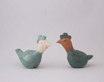 2 small enameled clay blue, green and natural earth hens