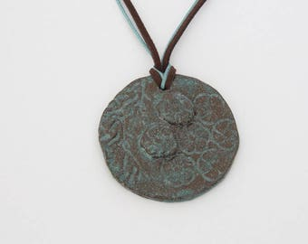 Necklace pendant in Brown and Blue ceramic round flower print