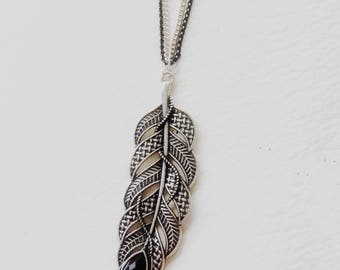 Long silver necklace, feather pendant