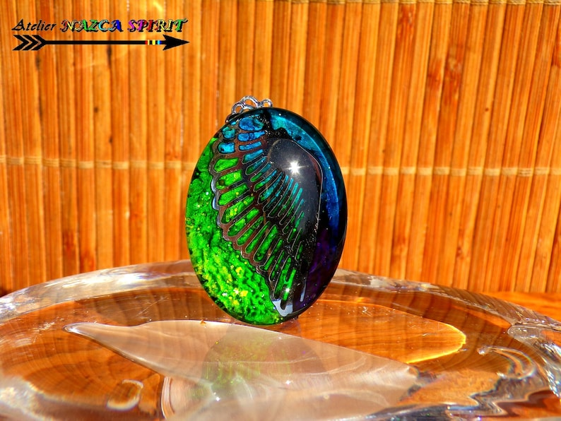 Ethnic Boho pendant  Unique craft Creation  Cabochon oval glass 4 cm steel angel wing  Iridescent green blue 1.57