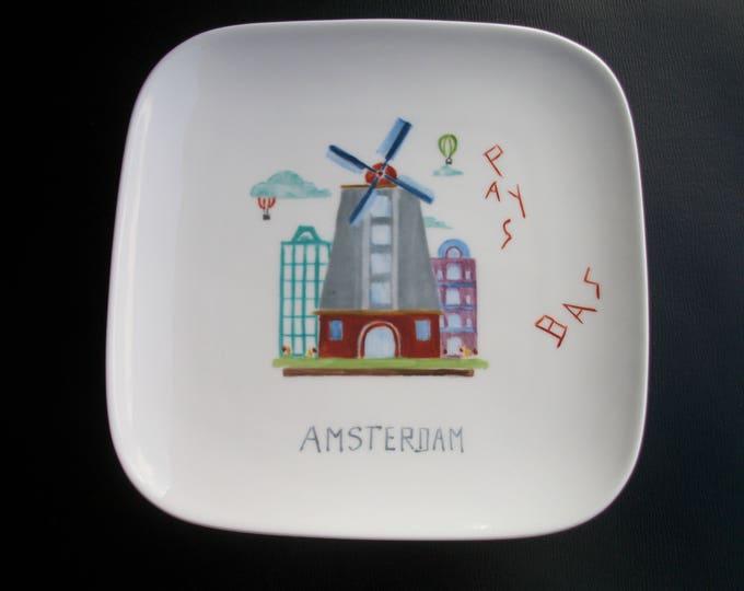 plate / entry / /peinte hand on porcelain dessert / Amsterdam / Netherlands