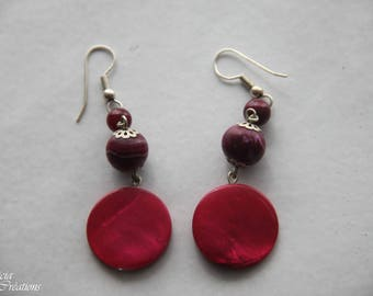 These handmade polymer clay earrings pink