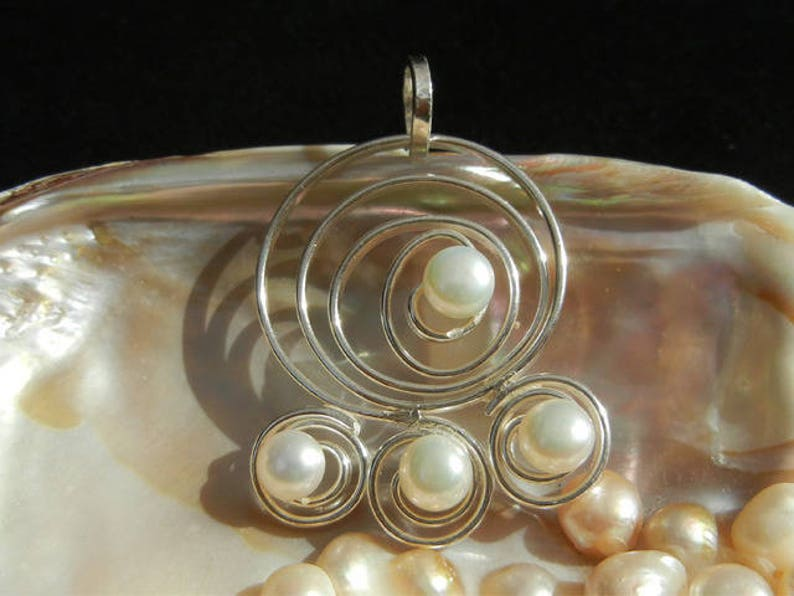 Cultured pearls and 925 Sterling Silver Wave pendant