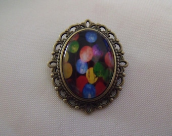 LIQUIDATION Oval brooch bronze color cabochon black and multicolored glass