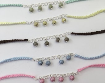Glitter beads and braided bracelet