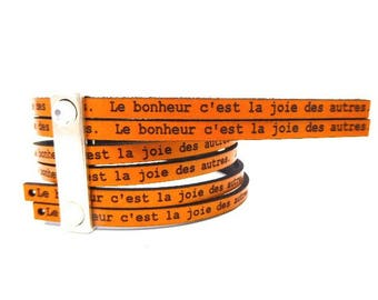 5 mm flat leather Tan with message happiness is the joy of others, sold by 20 cm