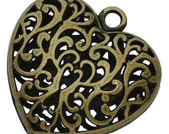 Bronze ornate metal heart charm
