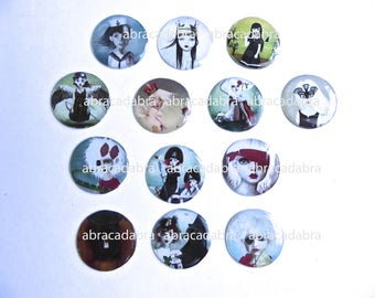 13 cabochons strange theme silicone on white cardstock 25 mms