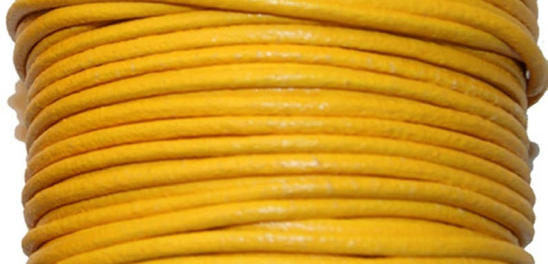 Leather thong 2 mm round yellow sold by 20 cm