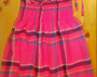 girl in madras smocked dress
