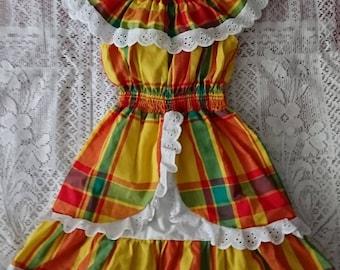 Woman madras and smocked dress