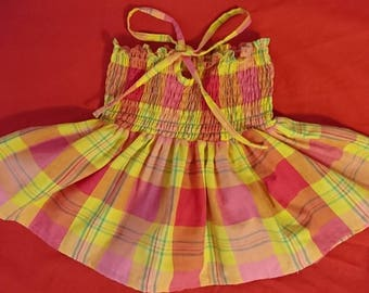 Skirt in madras and smocked dress