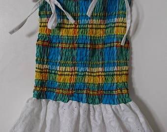 Girl in madras eyelet dress