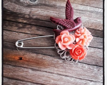 Silver filigree pin and orange flowers