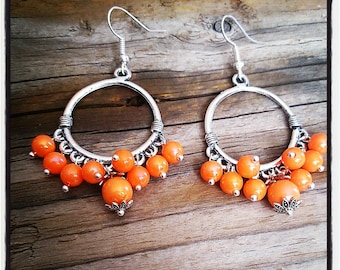 sleeper earrings silver ring and orange beads