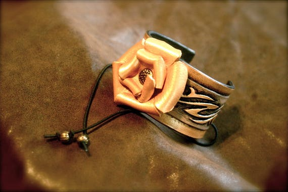 Original fantasy jewelry leather bracelet tooled with grey gold leather flower by Margaery