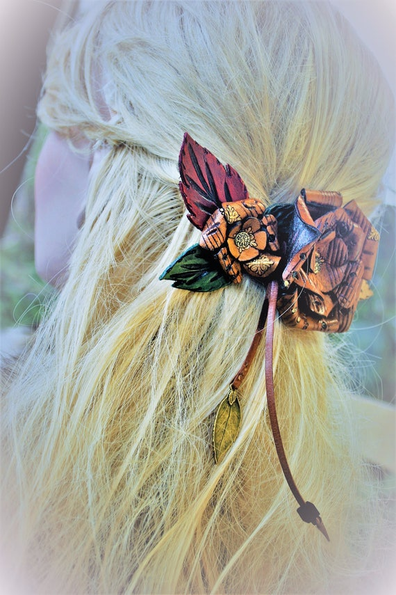 Leather Hair clasp, clip, of Renaissance, medieval, molded and carved roses, musicians, entertainers