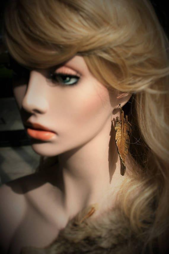 Feather shaped leather earrings, trompe l'oeil