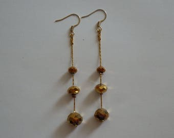 Dangling earrings faceted gold
