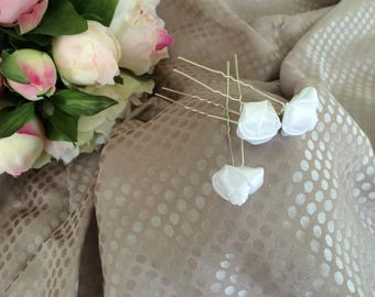 Set of three white satin flower hair pins