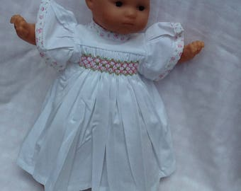 Dress has smocked white frill sleeves, ref 11