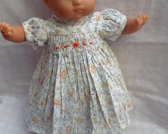Dress has smocked flowers ref 16 dolls clothes