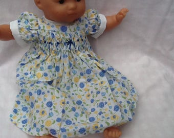 Dress has smocking with blue and yellow flowers ref 29