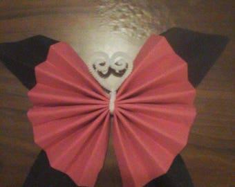 Butterfly shape folding towel Fuchsia and black