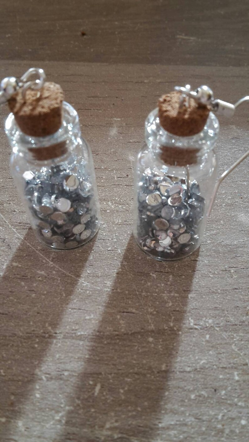 Flared earrings with silver rhinestones
