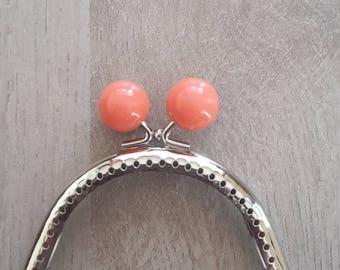 Clasp of purse orange