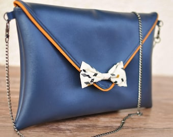 Metallic blue pouch and Twist Mustard bow purse