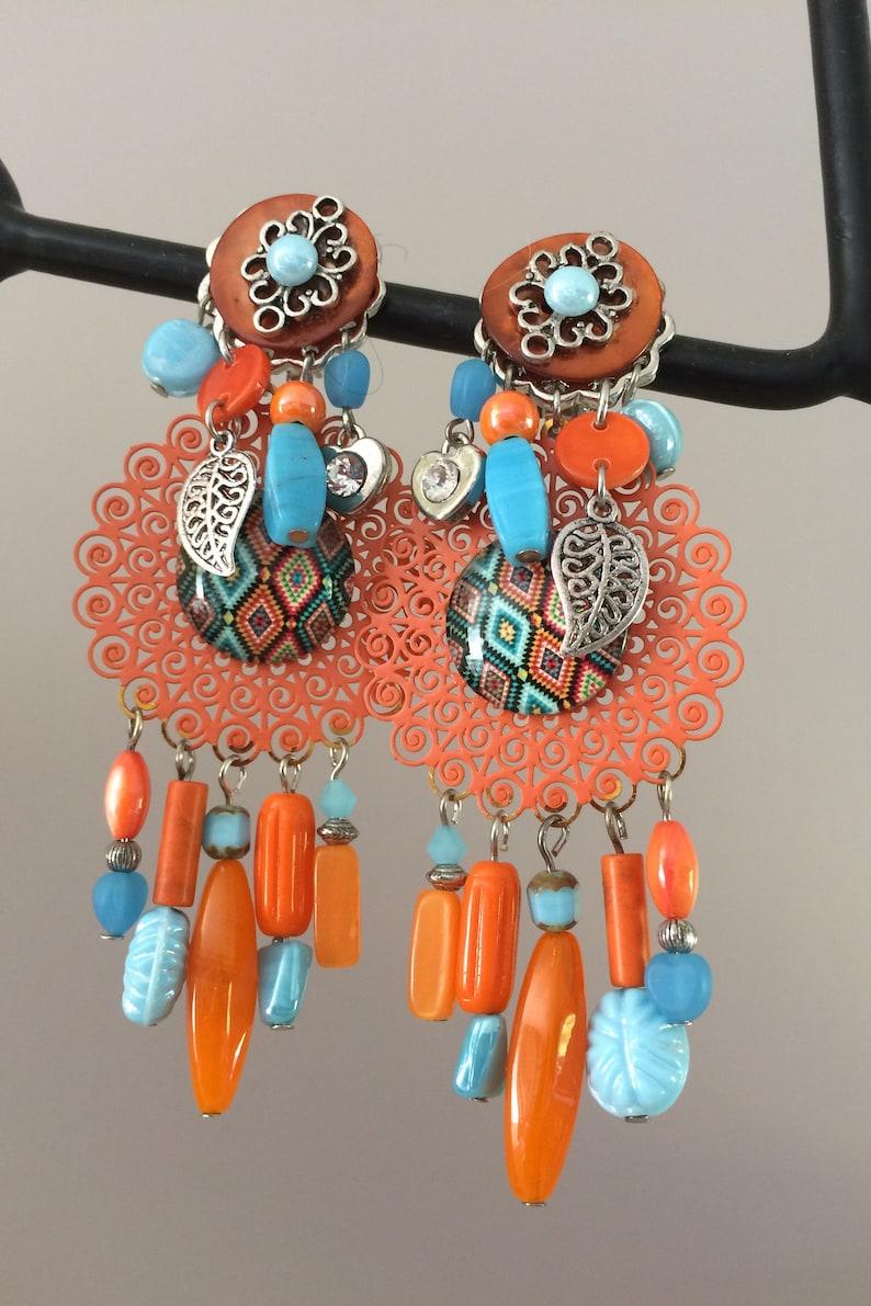 Very pretty fancy earrings clips of orange and light blue