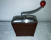 A metal coffee mill from Germany, manufactured by quot SWM Exact quot . Antique Coffee Grinder. Old Coffee Mill