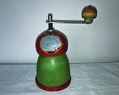 Cylindrical coffee mill with a Russian type of wood. Antique Coffee Grinder. Old Coffee Mill