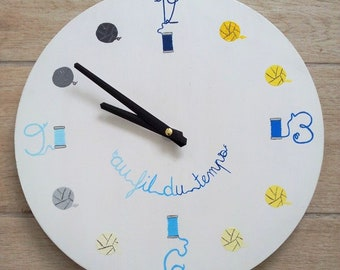 Wooden clock themed blue and yellow stitching