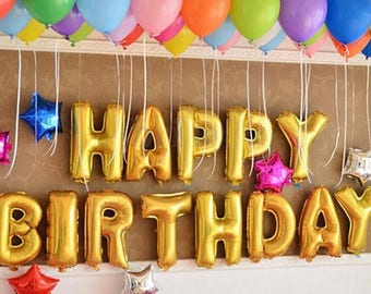 Gold birthday party balloons