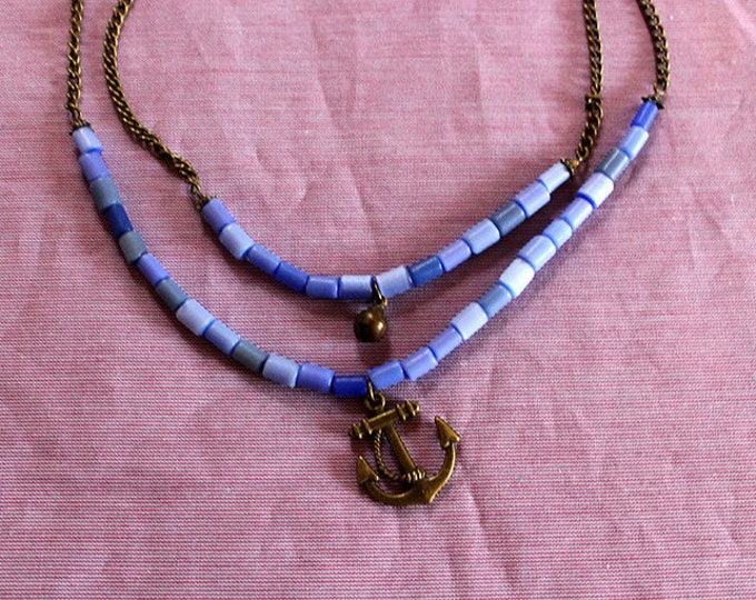 Double strand blue and brass chain necklace