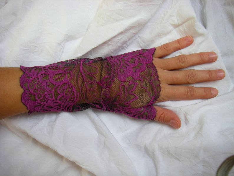 lace fingerless gloves Fuchsia on a dark background patterns