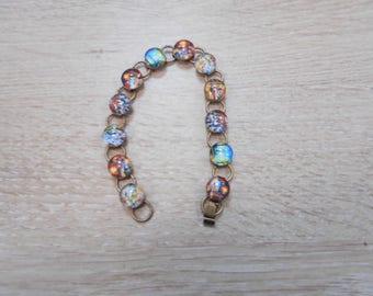1 bracelet with 10 mm glass cabochon bronze size 19 cm