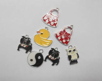 7 different charms size 2x1cm
