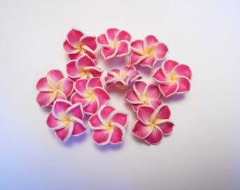 Flower polymer as pictured 12 beads drilled size 1.50 cm