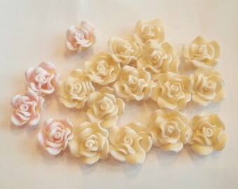 18 flower polymer as shown drilled beads size 2 cm